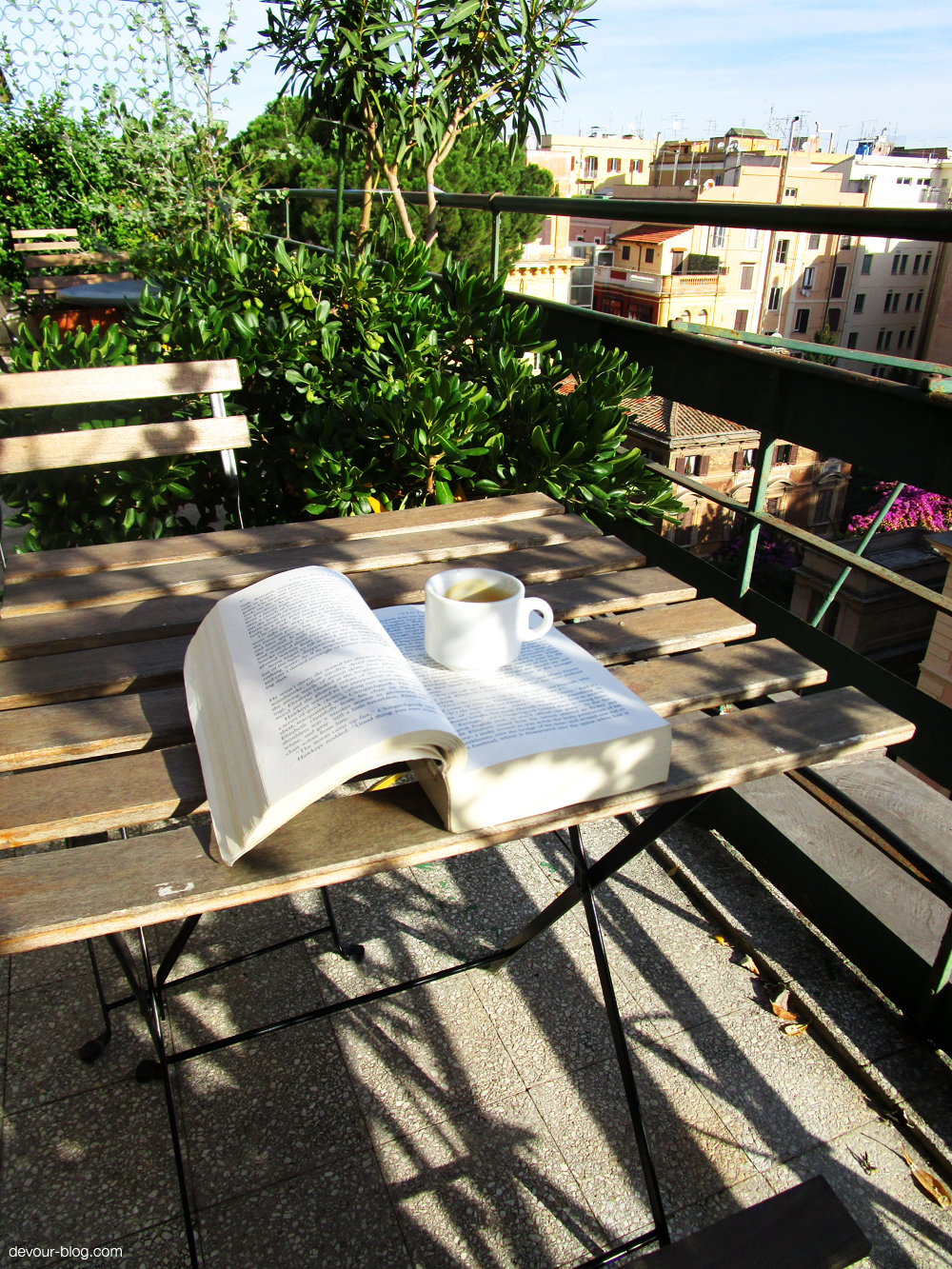 Roman mornings: espresso & a good book on our terrace.